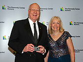 United States Senator Patrick Leahy (Democrat of Vermont) takes a photo of the photographers as he and his wife, Marcelle arrive for the formal Artist's Dinner honoring the recipients of the 41st Annual Kennedy Center Honors hosted by United States Deputy Secretary of State John J. Sullivan at the US Department of State in Washington, D.C. on Saturday, December 1, 2018. The 2018 honorees are: singer and actress Cher; composer and pianist Philip Glass; Country music entertainer Reba McEntire; and jazz saxophonist and composer Wayne Shorter. This year, the co-creators of Hamilton­, writer and actor Lin-Manuel Miranda, director Thomas Kail, choreographer Andy Blankenbuehler, and music director Alex Lacamoire will receive a unique Kennedy Center Honors as trailblazing creators of a transformative work that defies category.<br /> Credit: Ron Sachs / Pool via CNP