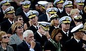 A Navy Officer get emotional at a memorial for the victims of the Washington Navy Yard shooting at the Marine Barracks, September 22, 2013 in Washington, D.C. United States President Barack Obama and first lady Michelle Obama also visited with families of the victims.<br /> Credit: Olivier Douliery / Pool via CNP
