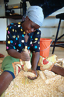 Kenya. Western Province. Kakamega. Kenya Agricultural Research Institute (KARI). As part of a program to improve food security in Kenya, the Insect Resistant Maize for Africa (IRMA) project is stocking maize seeds for scientific researches. A woman is shelling cobs by hands. © 2004 Didier Ruef