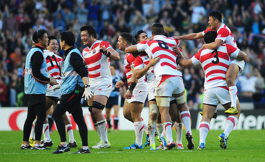 Japan celebrate their 34-32 victory over South Africa<br /> <br /> Photographer Kevin Barnes/CameraSport<br /> <br /> Rugby Union - 2015 Rugby World Cup - Japan v South Africa - Saturday 19th September 2015 - The American Express Community Stadium - Falmer - Brighton<br /> <br /> &copy; CameraSport - 43 Linden Ave. Countesthorpe. Leicester. England. LE8 5PG - Tel: +44 (0) 116 277 4147 - admin@camerasport.com - www.camerasport.com