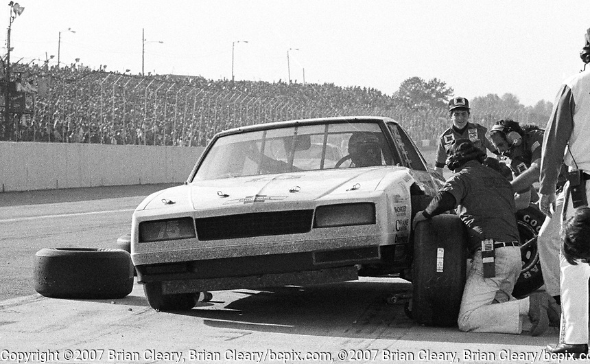 Atlanta Journal 500 at Atlanta International Raceway in Hampton, GA on November 6, 1983. (Photo by Brian Cleary/www.bcpix.com)  Atlanta Journal 500, Atlanta Motor Speedway, Hampton, Georgia, November 6, 1983.  (Photo by Brian Cleary/www.bcpix.com)  Neil Bonnett makes a pit stop in the #75 Hodgdon RayMoc Racing Chevrolet Monte Carlo en route to first place, Atlanta Journal 500 at Atlanta International Raceway in Hampton, GA on November 6, 1983. (Photo by Brian Cleary/www.bcpix.com)