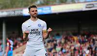 Peterborough United's Matthew Godden celebrates scoring the opening goal <br /> <br /> Photographer Chris Vaughan/CameraSport<br /> <br /> The EFL Sky Bet League One - Scunthorpe United v Peterborough United - Saturday 13th October 2018 - Glanford Park - Scunthorpe<br /> <br /> World Copyright &copy; 2018 CameraSport. All rights reserved. 43 Linden Ave. Countesthorpe. Leicester. England. LE8 5PG - Tel: +44 (0) 116 277 4147 - admin@camerasport.com - www.camerasport.com