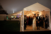 Washington, DC - November 24, 2009 -- United States President Barack Obama and First Lady Michelle Obama share a laugh, while leaving the State Dinner that was held in a tent on the South Lawn of the White House, November 24, 2009. .Mandatory Credit: Pete Souza - White House via CNP