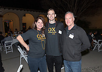 Jennifer Townsend Crosthwaite '84 P'20, Jonny Crosthwaite '20 and Barry Crosthwaite '80 P'20<br /> Now in his 30th year as Oxy's head men's basketball coach, Brian Newhall received a much deserved celebration with a surprise halftime ceremony and post game reception in the Booth Hall courtyard with more than 70 former and current players from all different generations and decades in attendance, on Saturday, Jan. 26, 2019.<br /> Newhall is the winningest coach in Oxy history and has a 100 percent graduation rate in his 30 years at the helm of the program. His resume boasts multiple SCIAC Championships and NCAA Playoff appearances, along with a run to the NCAA Division III Elite Eight in 2003 and the only perfect 14-0 season in SCIAC history. Newhall has not only coached at Oxy, but was a SCIAC Champion and SCIAC Player of the Year during his playing career at Oxy in the early 80s.<br /> (Photo by Marc Campos, Occidental College Photographer)