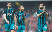 Southampton's Wesley Hoedt; Ryan Bertrand and Charlie Austin after the EPL - Premier League match between Arsenal and Southampton at the Emirates Stadium, London, England on 8 April 2018. Photo by Andrew Aleksiejczuk / PRiME Media Images.