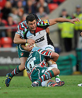 Leicester, England. Nick Easter of Harlequins tackled during the Aviva Premiership match between Leicester Tigers and Harlequins at Welford Road on September 22, 2012 in Leicester, England.