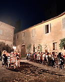 ITALY, Siena, crowd of people dining together outdoors at the Castello Di Spannochia.