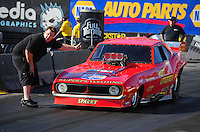Feb. 17 2012; Chandler, AZ, USA; NHRA nostalgia funny car crew member Brad Littlefield (left) directs driver Jason Rupert into the staging beams during qualifying for the Arizona Nationals at Firebird International Raceway. Mandatory Credit: Mark J. Rebilas-