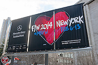 Billboard announces the Fall 2014 Fashion Week shows in Lincoln Center in New York, seen on opening day, Thursday, February 6, 2014. This year some designers are abandoning the tents at Lincoln Center to hold their shows at far flung venues, including Brooklyn.  (© Richard B. Levine)