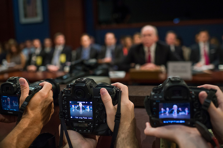 UNITED STATES - MAY 23: Photographers take pictures of former CIA director John Brennan testify before the House Permanent Select Committee on Intelligence in the Capitol Visitor Center on Russian ties to the 2016 election on May 23, 2017. (Photo By Tom Williams/CQ Roll Call)