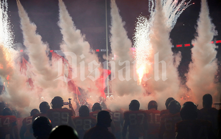 The Ohio State Buckeyes take the field with smoke, lasers and pyrotechnics for a night football game against the Nebraska Cornhuskers at Ohio Stadium in Columbus on Nov. 5, 2016. Ohio State won 62-3. (Adam Cairns / The Columbus Dispatch)