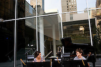 NEW YORK - JULY 9: Miranda Cuckson, violin, Christopher Gross, cello, and Philip Fisher, piano, perform a free concert, the Juliard Concert I: Music for Violin, Cello, and Piano, at The Abby Aldrich Rockefeller Sculpture Garden at the Museum of Modern Art on July 9, 2006, in New York City. (Photo by Landon Nordeman for The New Yorker)