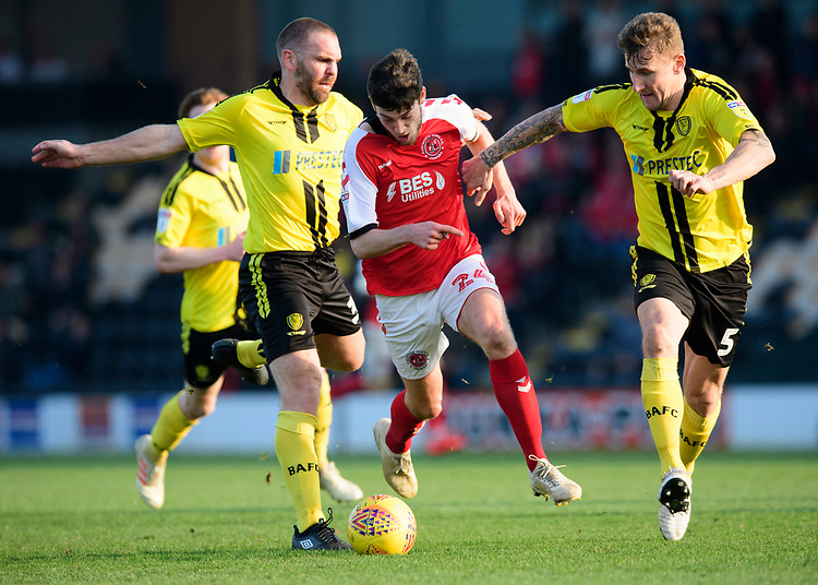 Fleetwood Town's Ashley Nadesan vies for possession with Burton Albion's Jake Buxton, left, and Burton Albion's Kyle McFadzean<br /> <br /> Photographer Chris Vaughan/CameraSport<br /> <br /> The EFL Sky Bet League One - Saturday 23rd February 2019 - Burton Albion v Fleetwood Town - Pirelli Stadium - Burton upon Trent<br /> <br /> World Copyright © 2019 CameraSport. All rights reserved. 43 Linden Ave. Countesthorpe. Leicester. England. LE8 5PG - Tel: +44 (0) 116 277 4147 - admin@camerasport.com - www.camerasport.com