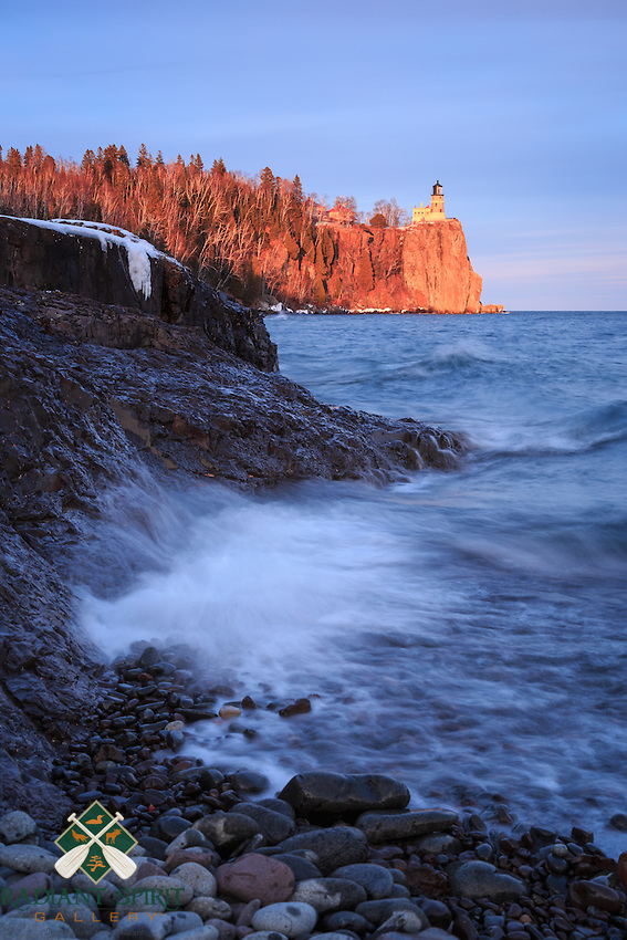 &quot;Golden Hour at Split Rock Lighthouse&quot;<br /> As the sun sank toward the horizon, Split Rock Lighthouse was bathed in its magic light, while gentle waves lapped at Lake Superior's shores. Just a short drive up the shore from Duluth, Minnesota, Split Rock Lighthouse State Park is a favorite destination for many visitors and locals. Set atop a 130 foot (40 m) cliff on Lake Superior, the elevation of the light is 168 feet (51 m), and was visible from 25 miles (40 km) or more. The Fresnel lens is a 2.5-ton, double bull&rsquo;s-eye lens.The lighthouse was built following the fateful Mataafa Storm of 1905, in which 29 ships were lost. It guided ships from 1910 through 1969, at which time it was retired and added to the National Register of Historic Places.