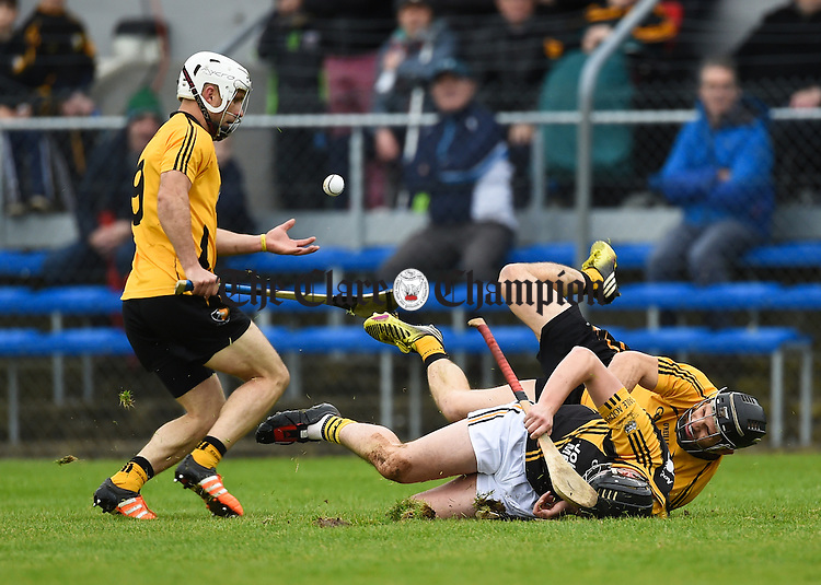 Eoghan Donnellan of Ballyea in action against Cormac O Donovan and Domhnall O Donovan of Clonlara during the senior hurling county final at Cusack park. Photograph by John Kelly.
