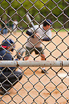 Even with the focus on the fence, there's no mistaking the great American pasttime of a baseball game in the park, New York, USA.