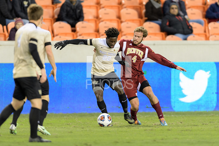 Houston, TX - Friday December 9, 2016: Reagan Dunk (4) of the Denver Pioneers battles for the ball against Ema Twumasi (22) of the Wake Forest Demon Deacons in the first half of the  NCAA Men's Soccer Semifinals at BBVA Compass Stadium.