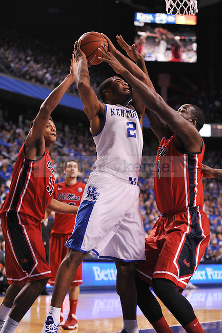 UK guard Aaron Harrison tries to shoot the ball while Ole Miss forward Sebastian Saiz (11) and center Demarco Cox (4) try to block him during the first half of the UK men's basketball team vs Ole Miss at Rupp Arena in Lexington, Ky., on Tuesday, February 4, 2014. Photo by Eleanor Hasken | Staff