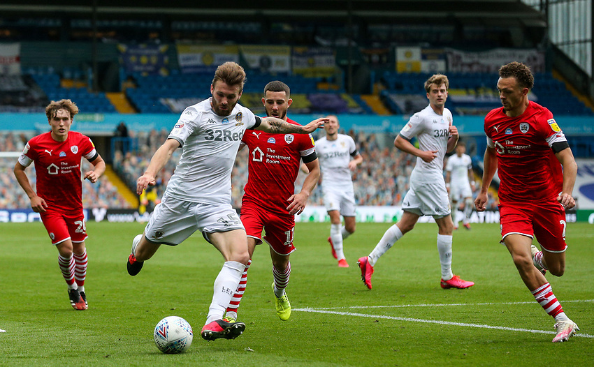 Leeds United's Stuart Dallas takes on Barnsley's Jordan Williams<br /> <br /> Photographer Alex Dodd/CameraSport<br /> <br /> The EFL Sky Bet Championship - Leeds United v Barnsley - Thursday 16th July 2020 - Elland Road - Leeds<br /> <br /> World Copyright © 2020 CameraSport. All rights reserved. 43 Linden Ave. Countesthorpe. Leicester. England. LE8 5PG - Tel: +44 (0) 116 277 4147 - admin@camerasport.com - www.camerasport.com