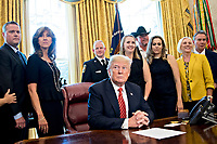 United States President Donald Trump, center, waits to speak next to Tammie Jo Shults, a Southwest Airlines Co. captain, second left, and Darren Ellisor, a Southwest Airlines first officer, left, while meeting with the crew and passengers of Southwest Airlines flight 1380 in the Oval Office of the White House in Washington, D.C., U.S., on Tuesday, May 1, 2018. An engine on Southwest's flight 1380, a Boeing Co. 737-700 bound for Dallas from New York's LaGuardia airport, exploded and made an emergency landing on April 17 sending shrapnel into the plane and killing a passenger seated near a window. <br /> Credit: Andrew Harrer / Pool via CNP /MediaPunch