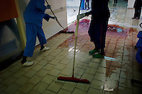Tripoli, Libya, August 27, 2011.Cleaning personnel start to clen up the hospital on the day after more than 100 bodies have been recovered in Abu Salim Hospital before being transfered to a functionning morgue in another Tripoli hospital. Details of what happened are unclear, but it seems some were wounded Khaddafi soldiers and were executed on their hospital beds..