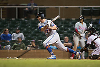 Scottsdale Scorpions designated hitter Peter Alonso (20), of the New York Mets organization, follows through on his swing in front of catcher Daulton Varsho (8) during an Arizona Fall League game against the Salt River Rafters at Salt River Fields at Talking Stick on October 11, 2018 in Scottsdale, Arizona. Salt River defeated Scottsdale 7-6. (Zachary Lucy/Four Seam Images)