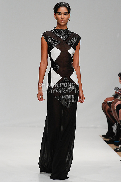 Model walks runway in an outfit from the J. Loren Fall 2014 collection, for Fashion's Collective Fall 2014, during New York Fashion Week Fall 2014, February 9, 2014.