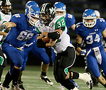 SIOUX FALLS, SD - OCTOBER 23: Jerry Kappenman #32 from McCook Central Montrose looks for room past Henry DeBerg #66 from Sioux Falls Christian in the first half of their game Thursday night at Bob Young Field. (Photo by Dave Eggen/Inertia)