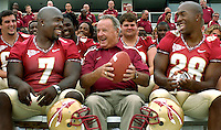 TALLAHASSEE, FL.8/13/06-FSU linebacker Buster Davis, left, and running back Lorenzo Booker, right, share a laugh with Coach Bobby Bowden during media day Sunday in Tallahassee. COLIN HACKLEY PHOTO