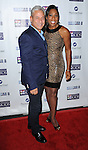 Greg Louganis and Dawnn Lewis at the Mending Kids Gala Honoring Gene Simmons and family, held at the Santa Monica Airport Hanger 8 on November 9, 2013
