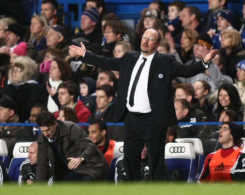 Dejected Chelsea's Interim Manager Rafael Benitez ..Football -  Capital One Cup Semi-Final - Chelsea v Swansea City - Wednesday 9th January 2013 - Stamford Bridge - London..