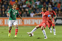 Bridgeview, IL, USA - Tuesday, October 11, 2016: Mexico forward Giovani dos Santos (10) and Panama midfielder Amílcar Henríquez (21) during an international friendly soccer match between Mexico and Panama at Toyota Park. Mexico won 1-0.
