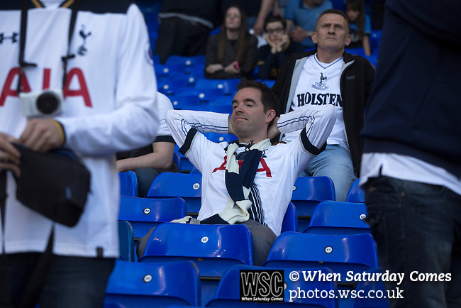 Tottenham Hotspur 4 Watford 0, 08/04/2017. White Hart Lane, Premier League. A supporter relaxing in the South Stand at the end of the game as Tottenham Hotspur took on Watford in an English Premier League match at White Hart Lane. Spurs were due to make an announcement in April 2016 regarding when they would move out of their historic home and relocate to Wembley as their new stadium was completed. Spurs won this match 4-0 watched by a crowd of 31,706, a reduced attendance figure due to the ongoing ground redevelopment. Photo by Colin McPherson.