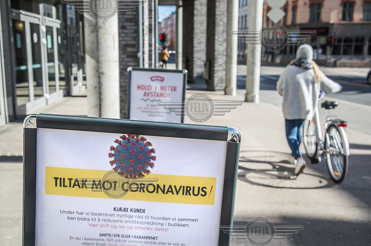 Sign informing about anti corona measures. Norwegian authorites introduced measures to combat the Coronavirus (COVID-19).<br /> <br /> Restriction on public gatherings, closure of schhols, new rules for those serving food and drinks, and fear of further spread of the virus have brought the country to a stand still. <br /> <br /> ©Fredrik Naumann/Felix Features