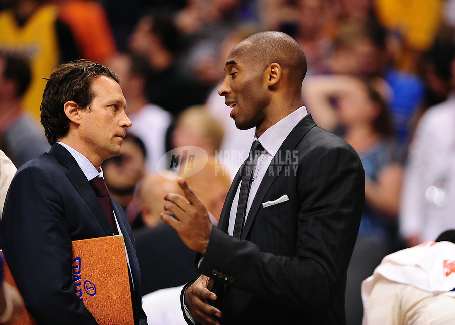 Apr. 7, 2012; Phoenix, AZ, USA; Los Angeles Lakers injured guard Kobe Bryant (right) talks with assistant coach Quin Snyder against the Phoenix Suns at the US Airways Center. The Suns defeated the Lakers 125-105.  Mandatory Credit: Mark J. Rebilas-USA TODAY Sports
