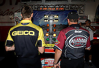 Jul. 26, 2013; Sonoma, CA, USA: NHRA top fuel dragster drivers Shawn Langdon (right) and Morgan Lucas play on the practice tree in the Toyota display during qualifying for the Sonoma Nationals at Sonoma Raceway. Mandatory Credit: Mark J. Rebilas-