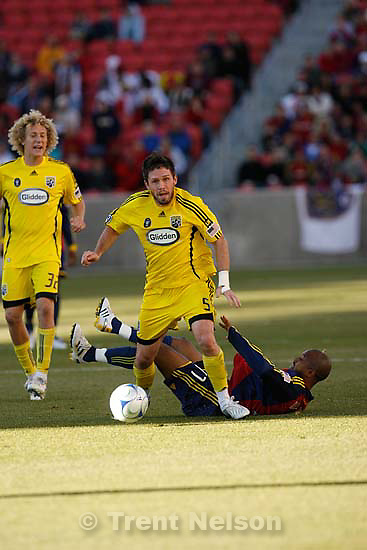 Columbus Crew defender Danny O'Rourke (5) brings the ball upfield ahead of Real Salt Lake midfielder Andy Williams (77). Real Salt Lake vs. Columbus Crew, MLS Soccer playoffs Saturday, October 31 2009 at Rio Tinto Stadium in Sandy.