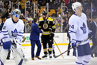 April 25, 2018: Toronto Maple Leafs head coach Mike Babcock shakes hands with Boston Bruins defenseman Zdeno Chara (33) after game seven of the first round of the National Hockey League's Eastern Conference Stanley Cup playoffs between the Toronto Maple Leafs and the Boston Bruins held at TD Garden, in Boston, Mass. Boston defeats Toronto 7-4 and wins the best of seven series 4 games to 3 to advance to round two.