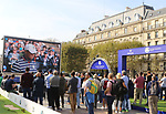 Fans look on a large screen in front of Paris City all at Europe and US golfer such as Tiger Woods playing during fourball match on the first day of the 42nd Ryder Cup at Le Golf National Course at Saint-Quentin-en-Yvelines, south-west of Paris on September 28, 2018.