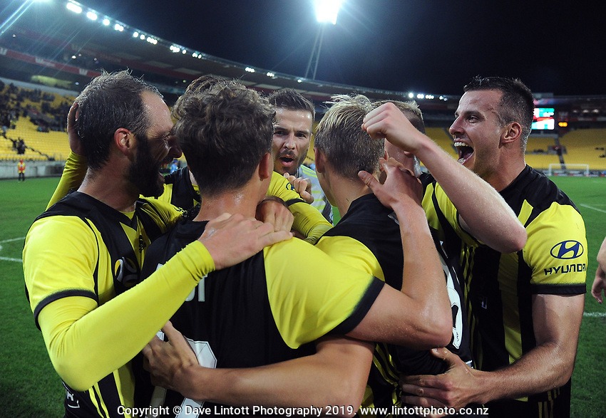 The Phoenix celebrate Roy Krishna's matchwinner during the A-League football match between Wellington Phoenix and Melbourne City FC at Westpac Stadium in Wellington, New Zealand on Sunday, 21 April 2019. Photo: Dave Lintott / lintottphoto.co.nz