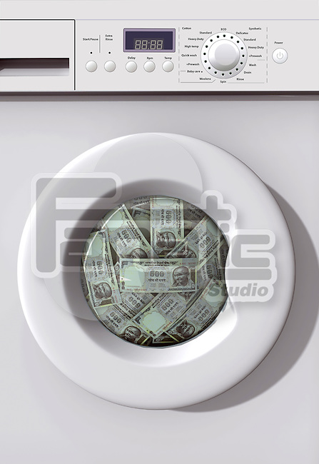 Money Laundry - a washing machine with Indian currency notes inside