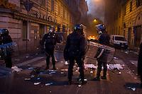 Alcuni carabinieri controllano una strada teatro di atti vandalici da parte dei black bloc.<br /> Carabinieri during the riots in Rome.