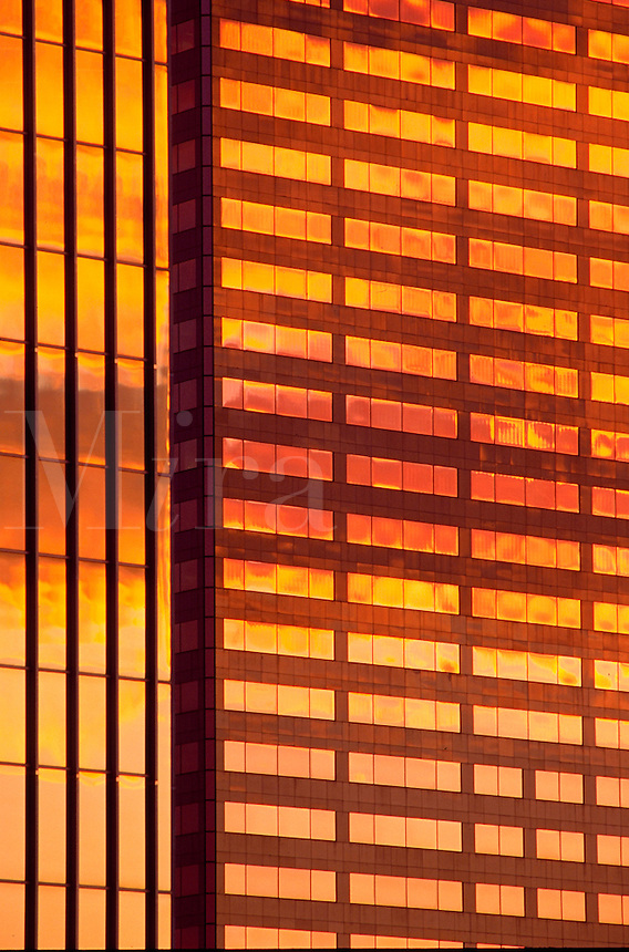 Abstract view of the exterior of the US Bankcorp Tower and ONe Main Place office building. Architectural detail of the windaos and reflected glow of sunset. Portland, Oregon.