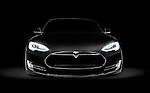 Black 2017 Tesla Model S luxury electric car front view isolated on dark black background with clipping path