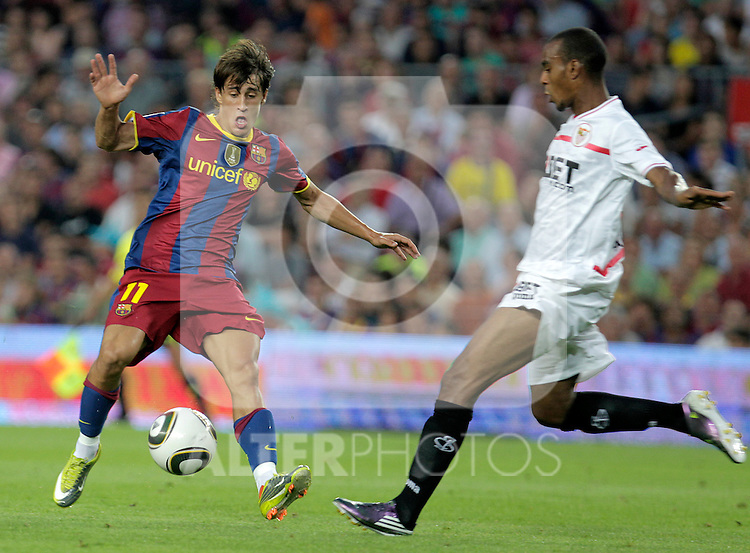 FC Barcelona's Bojan Krkic (l) and Sevilla's Abdoulay Konko during SuperCup of Spain Final match. August 21,2010. (ALTERPHOTOS/Acero)