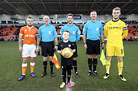 Blackpool's club captain Curtis Tilt (left) with Barnsley's captain Adam Davies (right), line up with the match mascot, referee Anthony Backhouse (centre) and assistant referees Gary Hilton (2nd left) and Barry Gordon  <br /> <br /> Photographer Rich Linley/CameraSport<br /> <br /> The EFL Sky Bet League One - Blackpool v Barnsley - Saturday 22nd December 2018 - Bloomfield Road - Blackpool<br /> <br /> World Copyright &copy; 2018 CameraSport. All rights reserved. 43 Linden Ave. Countesthorpe. Leicester. England. LE8 5PG - Tel: +44 (0) 116 277 4147 - admin@camerasport.com - www.camerasport.com
