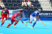 Lee Morton of Scotland carries the ball past Korean captain Manjae Jung during the Hockey World League 9th and 10th placing match between Korea and Scotland at the Olympic Park, London, England on 22 June 2017. Photo by Steve McCarthy.