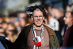 A Grimsby Town fan wearing a wig during the Vanamara Conference League match between Woking and Grimsby Town at the Kingfield Stadium, Woking, Surrey<br /> Picture by David Horn/eXtreme aperture photography +44 7545 970036<br /> 07/03/2015