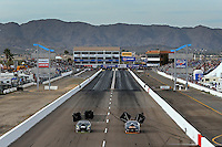 Feb 22, 2014; Chandler, AZ, USA; Overall view of Wild Horse Motorsports Park as NHRA pro stock driver Shane Tucker (left) races alongside Steve Kent during qualifying for the Carquest Auto Parts Nationals. Mandatory Credit: Mark J. Rebilas-USA TODAY Sports