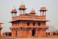 Fatehpur Sikri, Uttar Pradesh, India.  Diwan-i-Khas (Hall of Private Audience) of Emperor Jalal el-Din Akbar.  Chhatris on Corners of Roof.